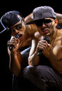 Rap concert with two muscular shirtless men with microphones Stock Photo