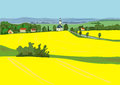 Rape field and village Royalty Free Stock Photo