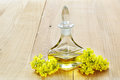 Rapeseed oil with rape flowers Royalty Free Stock Photo