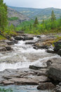 Rapid river flow in mountains Royalty Free Stock Photo