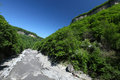 Rapid river narrow mountain path in russia republic of adygea sunny and clear day Stock Image
