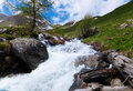 Rapid stream in mountains Royalty Free Stock Images