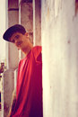 Rapper leaning on a wall young against Royalty Free Stock Photo