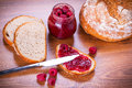 Rapsberry jam with slice of bread on wooden table Royalty Free Stock Image