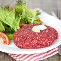 Rare burger with salad on a plate Stock Photos