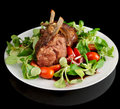 Rare fried rack of lamb isolated on black Stock Image