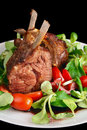 Rare fried rack of lamb isolated on black Royalty Free Stock Photography
