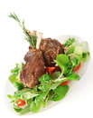 Rare fried rack of lamb  on white Stock Photography