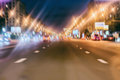 Rare night cars. Abstract blurred colorful background of urban street night traffic with bokeh lights, city street Royalty Free Stock Photo