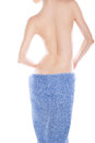 Rare view of slim woman after bath with towel young blue over white Royalty Free Stock Photo