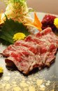 Rare wagyu beef served on black platter Royalty Free Stock Image
