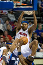 Rasheed wallace dunks on dallas of the detroit pistons the ball during a game against the mavericks at the the palace of auburn Royalty Free Stock Images