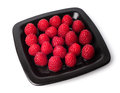 Raspberries on a black plate Royalty Free Stock Photography