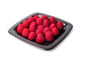 Raspberries on a black plate Stock Image
