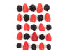 Raspberries and blackberries are laid out in a square on a white Royalty Free Stock Photo