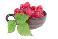 Raspberries in the cup isolated on white background Stock Photo