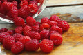 Raspberries fresh on a wooden background Royalty Free Stock Photography
