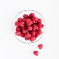 Raspberries in a glass bowl Stock Photos