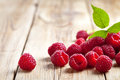Raspberries with leaf on wooden table background copy space Stock Photos