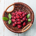 Raspberries with leaves in basket Royalty Free Stock Photo