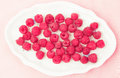 Raspberries in a plate delicious Royalty Free Stock Photography