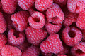 Raspberries raspberry many red berry fruit vegetarian nutrition food closeup vitaminic agricultural palatable eat salubrious Royalty Free Stock Photography