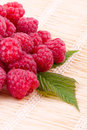 Raspberries on straw mat closeup fresh fruits a Stock Photos