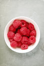 Raspberries in white cup shot from overhead narrow depth of field Stock Photos