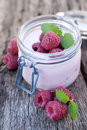 Raspberries with yogurt Royalty Free Stock Images