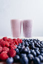 Raspberry and blueberry smoothie with fresh berries on wood tabl Royalty Free Stock Photo