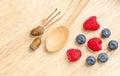 Raspberry and blueberry on wood background, Fresh fruit Royalty Free Stock Photo