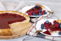 Raspberry cake and slices of cake with fresh berries pie tasty filling raspberries blueberries Stock Photo
