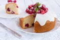 Raspberry cake with sugar icing on a white background Stock Photography