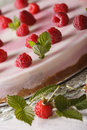 Raspberry cheesecake with mint macro on the table vertical plate Royalty Free Stock Photo