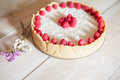 Raspberry cheesecake on a white wood background Royalty Free Stock Photography