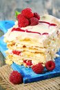 Raspberry and cream cake of puff pastry raspberries on the blue board Royalty Free Stock Photography