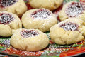 Raspberry cream cookies thumbprint on a holiday plate Royalty Free Stock Images