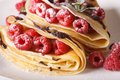 Raspberry crepes with chocolate frosting macro on a plate. horiz Royalty Free Stock Photo