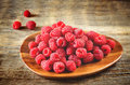 Raspberry on a dark wood background toning selective focus on the middle raspberries Stock Image
