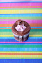Raspberry filled cupcake on colorful background Royalty Free Stock Images
