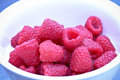 Raspberry fruit in bowl close up Stock Photo