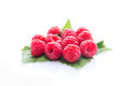 Raspberry fruit with leaf isolated on white Royalty Free Stock Photo