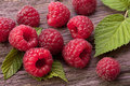 Raspberry fruit on wood Royalty Free Stock Photo