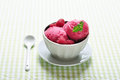 Raspberry ice cream in ceramic bowl with fresh berries and mint Stock Photos