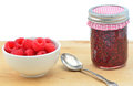 Raspberry jam fresh home made with bowl of fresh raspberries horizontal composition Stock Photography