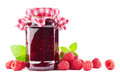 Raspberry jam jar with with raspberries on white Royalty Free Stock Image