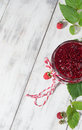 Raspberry jam in a jar on the wooden table and fresh berries light background Stock Image