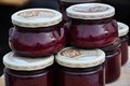 Raspberry jam jars Stock Photography