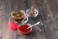 Raspberry jam on table with cup of herbal tea Royalty Free Stock Photo