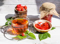 Raspberry jam and tea in cup Royalty Free Stock Photo